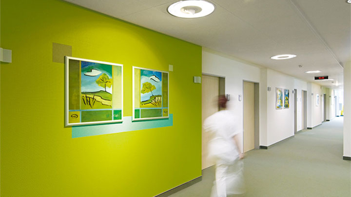 Nurse is walking in a corridor lit by Philips at the psychiatric clinic