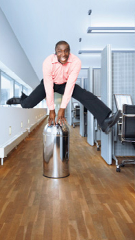 Man is jumping in a corridor of an office illuminated with Philips dynamic lighting